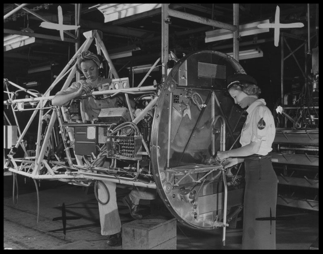 Above- Consolidated Vultee- All included assemblies, from firewall to control brackets, are installed by women. This photo on September 28, 1943