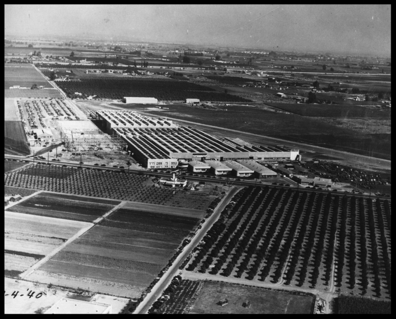 Vultee Aircraft in Downey, 1940. Alameda St. is seen here ending at Lakewood Blvd with Bellflower Blvd. surrounded by orange trees etc. just east of Lakewood Blvd. The sites first building is seen to the left of the Rotunda and Kaufmann Wing. Built by E.M. Smith in 1929 as Emsco Aircraft, the plant grew to five times its size by 1940. The Emsco Building and the original Vultee main offices (Rotunda and Kaufmann Wing's four buildings) still stand today (2017). In far distance would be the Rio San Gabriel River. Washburn Road is seen to the left of the plant and would end at Bellflower Blvd. by 1940.
