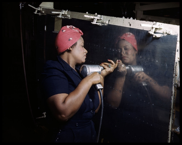 A real-life Rosie the Riveter operating a hand drill at Vultee-Nashville, Tennessee, working on an A-31 Vengeance dive bomber.1943