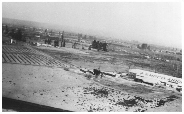 EMSCO Aircraft aerial view 1929 in Downey, CA. Alameda St. is seen in the upper left passing Alameda School. passing in front of the EMSCO plant is Cerritos Ave., now Lakewood Blvd. Image- Downey Historical Society