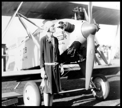 Amelia Earhart  with her Kinner Airster.