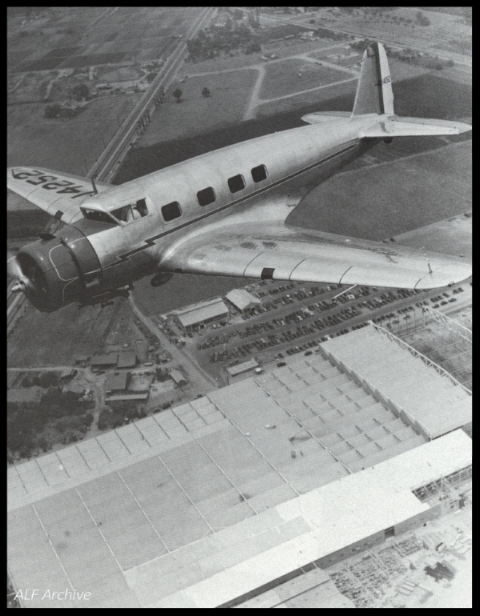 Vultee V-1A flys over Vultee Field in Downey, California.  Late 1940's.