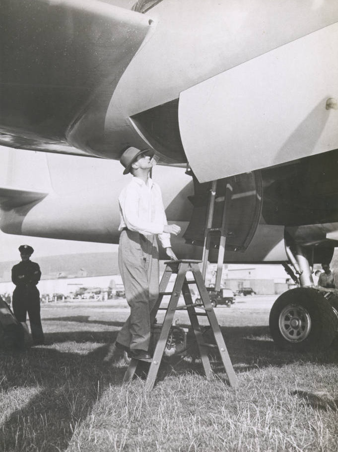 Howard Hughes climbing into the XF-11