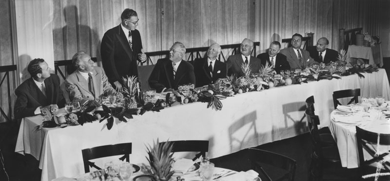 "At speakers table of banquet attended by leaders of Southern California's ""airplane arsenal of nation"" 1950"
