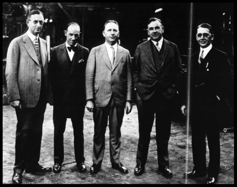 E.M. Smith (2nd from right) meets with Downey officials, 1933.