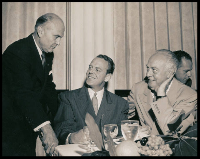 Photograph of General Eaker, Clark Clifford, and Dutch Kindelberger, attending a banquet, circa 1940s-1950s. Image- UNLV