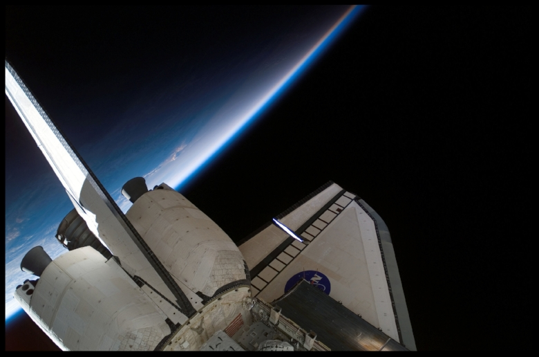 Space Shuttle orbiter with beautiful profile over the Earth...