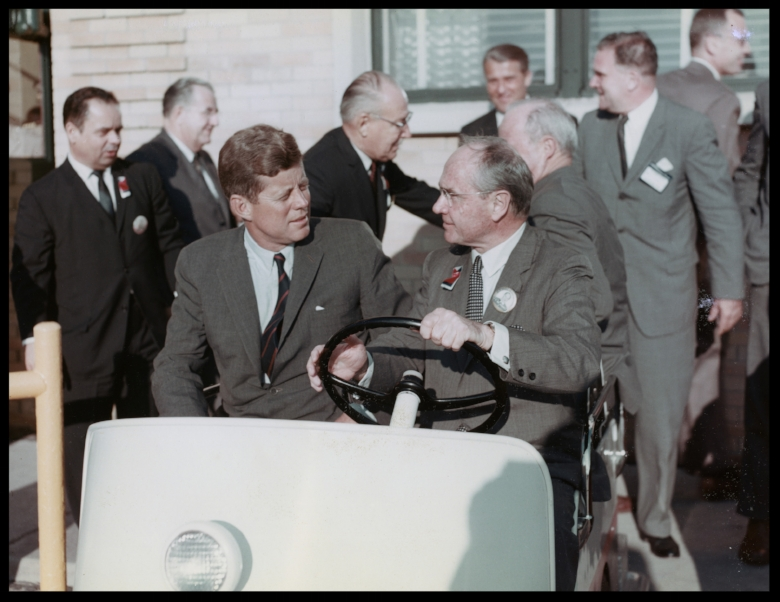 """Mac"" and President Kennedy on a golf cart ride. Image- Greater St. Louis Air and Space Museum"