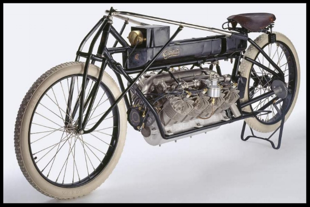 """Before achieving fame in aeronautics, Glenn Curtiss started his career with motorcycles. The early aviation community began to seek out Curtiss because of his growing reputation for designing powerful, lightweight motorcycle engines. In 1906 he designed his first V-8 engine in response to several requests from early aeronautical experimenters.""    Smithsonian Air & Space."