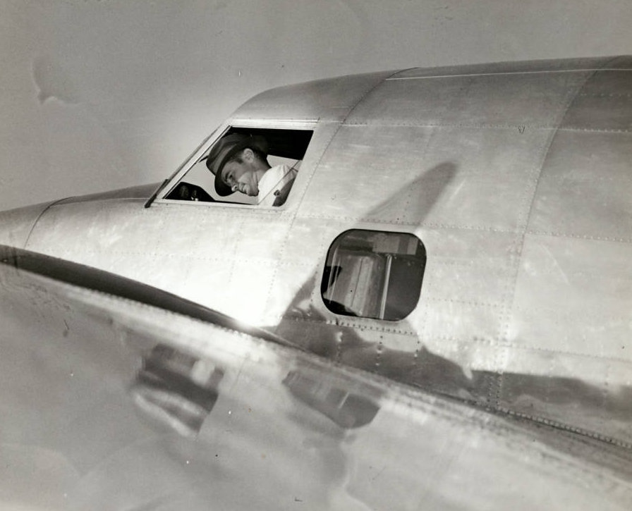 Photograph_of_Howard_Hughes_in_his_Lockheed_14_aircraft_Floyd_Bennett_Field_New_York_July_10_1938.jpg