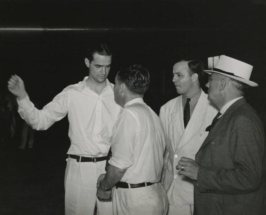 Photograph_of_Howard_Hughes_talking_to_an_unidentified_man_Chicago_1938.jpg