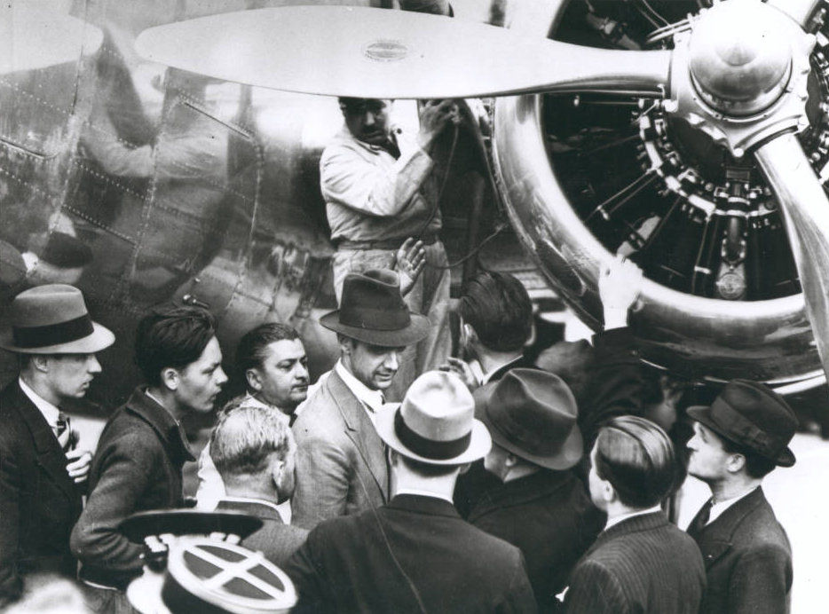 Photograph_of_Howard_Hughes_with_Lockheed14_plane_Le_Bourget_France_July_11_1938.jpg