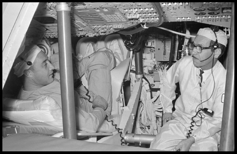 Astronaut Virgil I. Grissom and other members of the first Apollo crew inspect spacecraft equipment during a visit to North American Aviation.  NORTH AMERICAN AVIATION, INC., DOWNEY, CA , June 24, 1966.