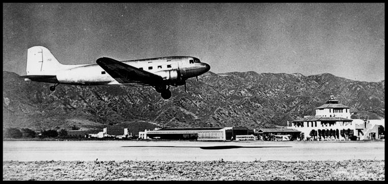 View is looking south over the Burbank Airport in the 1930s. A TWA airliner, Douglas DC-3, comes in for a landing. Image- LAPL