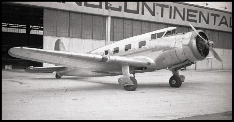 One-half right front view of a Vultee V1-A parked outside a hangar at Grand Central Airport, Glendale, CA, circa late 1930s. Image- National Air and Space Museum Archives