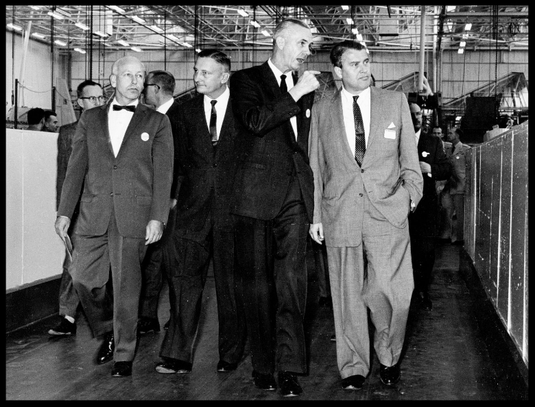 This is a photograph of Dr. Wernher von Braun, taken in 1961, visiting North American Aviation's Space and Information Systems Division in Downey, California.