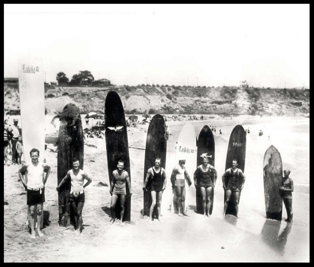 Gerald Vultee (third from left) and other surfers Corona Del Mar in the 1920's. More here about Vultee's surfing exploits...PDF
