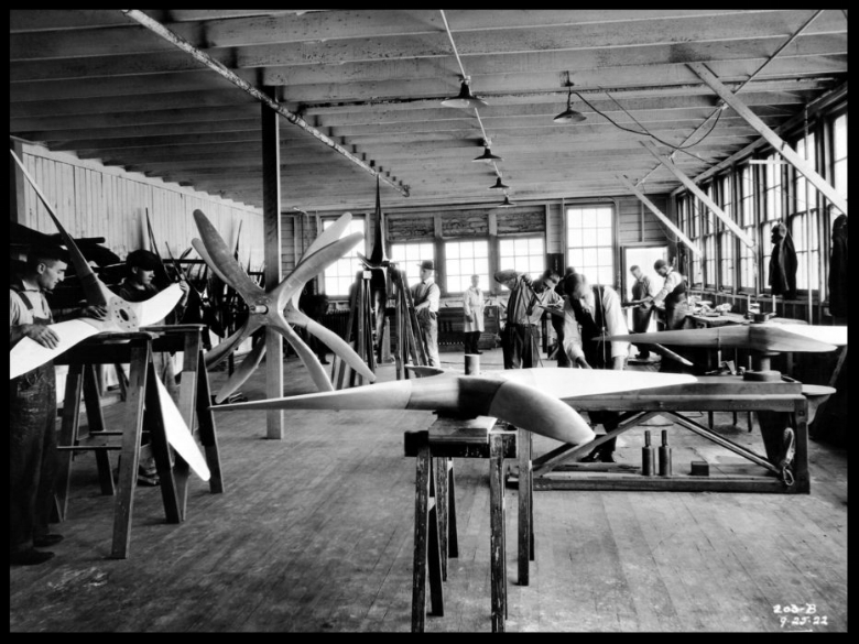 "Boeing built his first factory in a former shipyard on the banks of Washington's Duwamish River. In the ""Red Barn,"" craftsmen and women built parts by hand, primarily from wood and fabric. Image- Boeing"