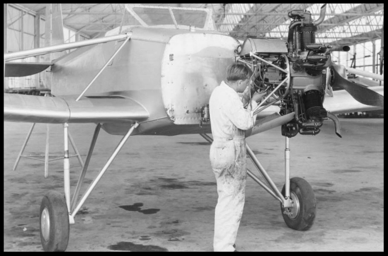 Above- Mechanic works on Kinner plane at hangar (Building 1) in Downey. 1933.  Image- Dick Whitington