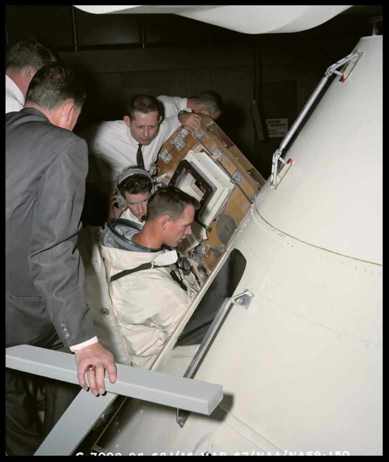 Astronaut David Scott in thermal meteoroid garment with Portable Life Support Systems PLSS during docking review. North American Aviation Inc. Downey plant, 1967. Image- NASA/Boeing