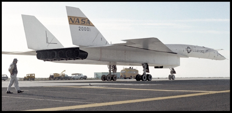 The figure standing on the ramp provides a relative size comparison with the XB-70A aircraft. Six large nozzles for the General Electric engines are shown 1968 .  Image- NASA