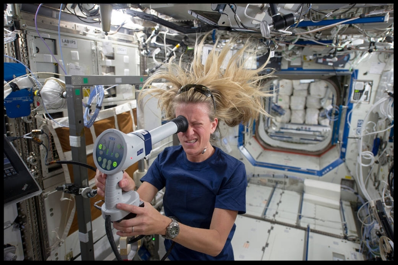 Astronaut Karen Nyberg of NASA uses a Fundoscope.  Image NASA  HRP  Images