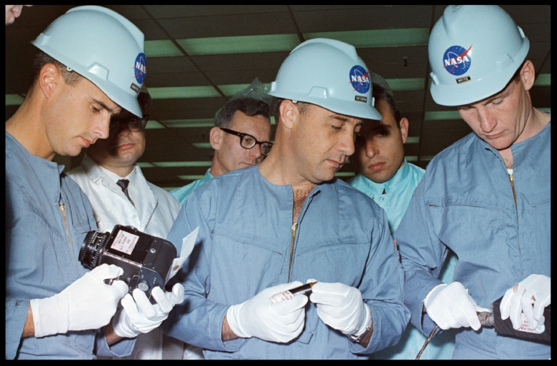 Above- The members of the prime crew of the first manned Apollo space flight Apollo/Saturn 204 AS-204 inspect spacecraft equipment during a tour of North American Aviation's NAA Downey facility. In the foreground, left to right, are astronauts Roger B. Chaffee, Virgil I. Grissom, and Edward H. White, II. NAA engineers and technicians are in the background. NORTH AMERICAN AVIATION, INC., DOWNEY, CA. NASA Image courtesy-  SJO'Connell