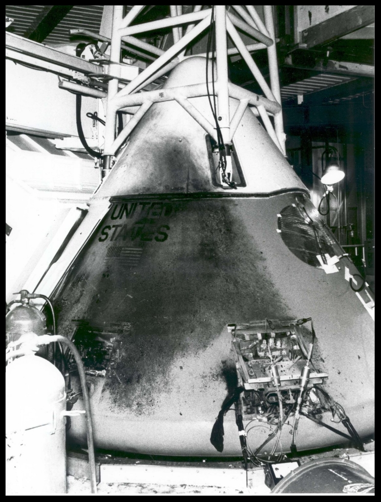 This photograph shows Apollo 1's Command Module a day after the fire that took the lives of astronauts Grissom, White and Chaffee