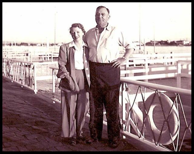 E.M. and Katharine on the dock at 501 Via Lido Soud house, now owned by Ramona Smith, wife of E.M.'s nephew Morrie Smith.jpg