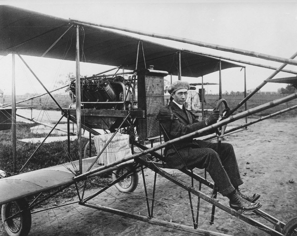 Glenn L. Martin in pusher-biplane. Note the newspapers stacked on wing.