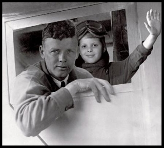 Charles A. Lindbergh and Anne Morrow Lindbergh with their Lockheed Sirius airplane.