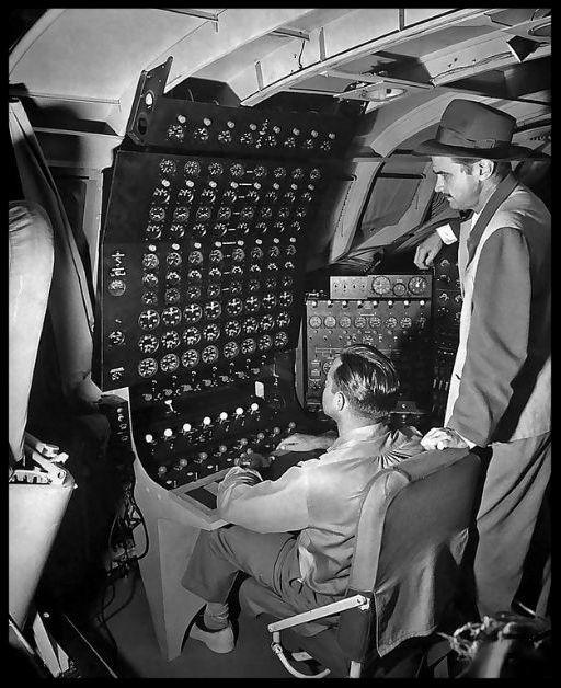 Above- Howard Hughes(right) in 1947.Hughes Hercules H-4