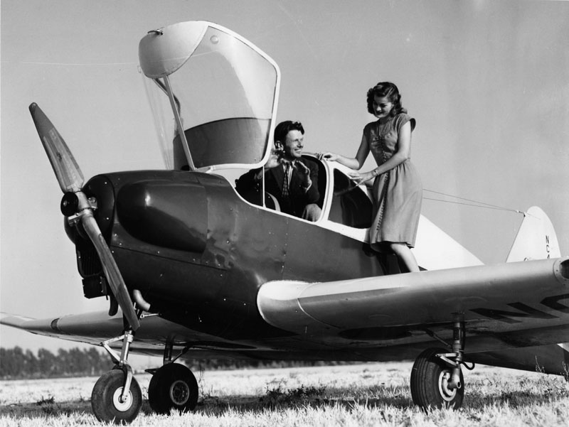 Aviator Doug Wrong Way Corrigan explains the right way to fly a 'Culver V' airplane to Ruth Reid of Grand Central Terminal (in Glendale).jpg