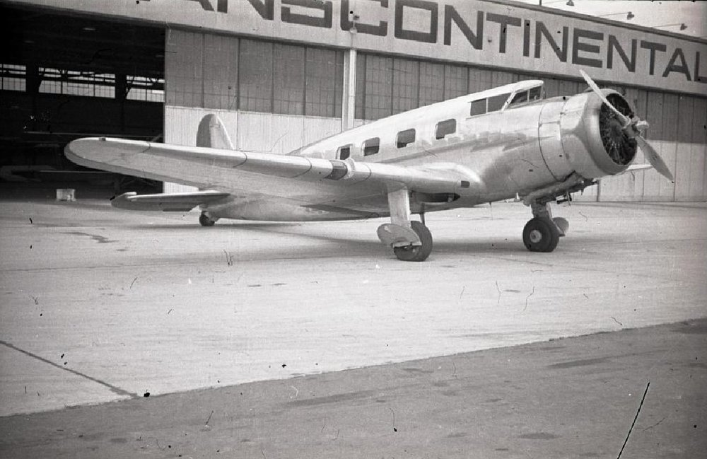 One-half right front view of a Vultee V1-A parked outside a hangar at Grand Central Airport, Glendale, CA, circa late 1930s.jpg