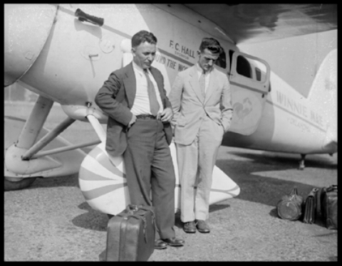 Wiley Post and Harold Gatty in Boston East Boston Airport 1931. Image- Wikipedia