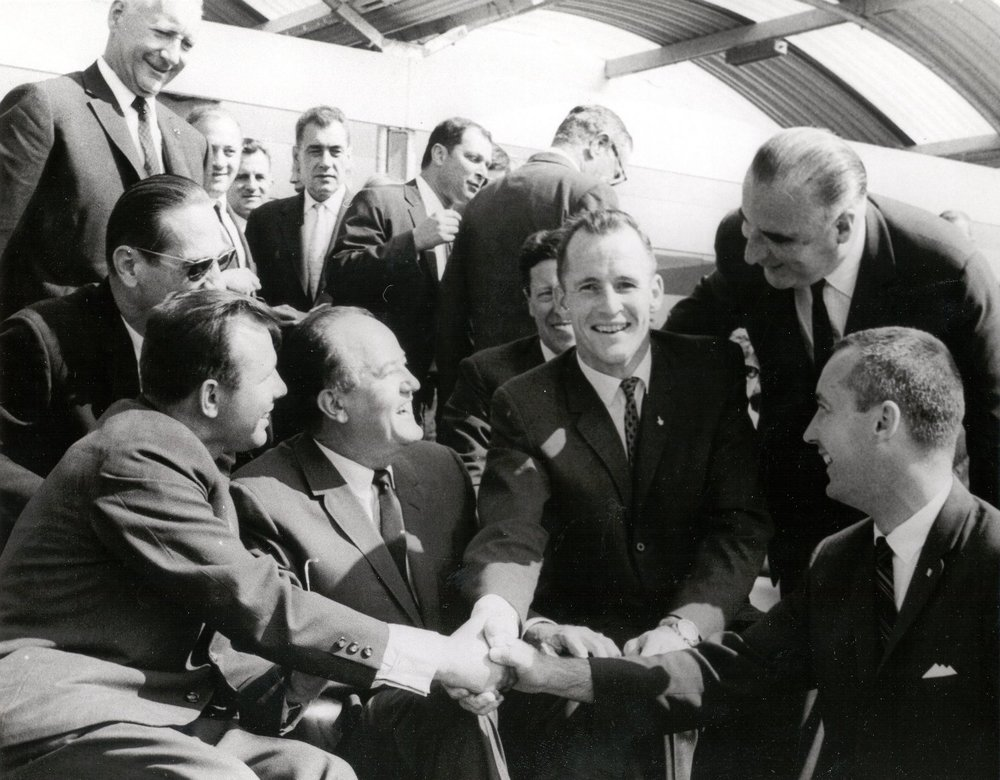 Soviet cosmonaut Yuri Gagarin shakes hand with NASA's Gemini 4 astronauts, Edward H. White II and James A. McDivitt at the Paris International Air Show in June 1965.