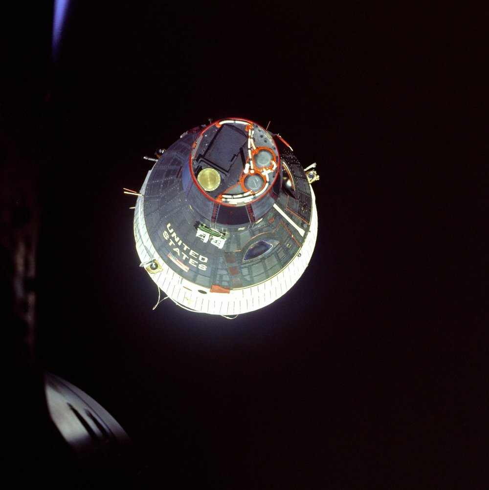 December 15, 1965 shows the Gemini 7 spacecraft as it was observed from the hatch window of the Gemini 6 spacecraft during rendezvous manuevers  19654