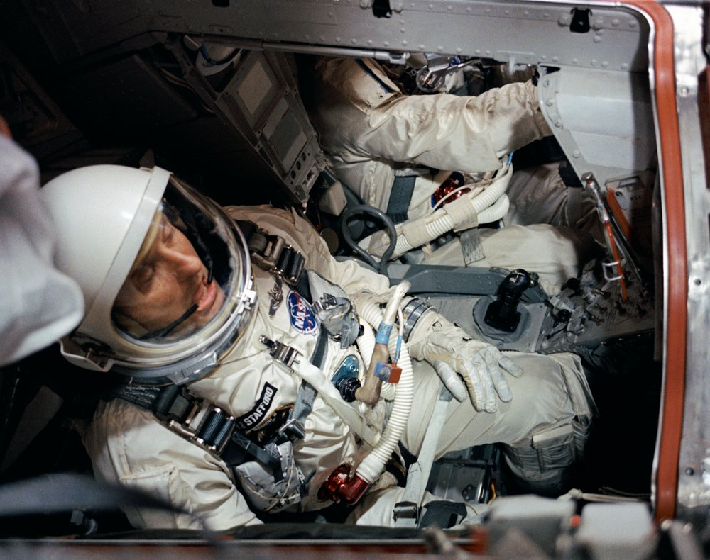Astronaut Thomas P. Stafford, pilot, is seen in the Gemini VI spacecraft in the White Room atop Pad 19 1965
