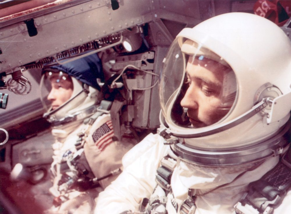 Astronauts Edward H. White II (left) and James A. McDivitt inside the Gemini IV spacecraft wait for liftoff.  1965