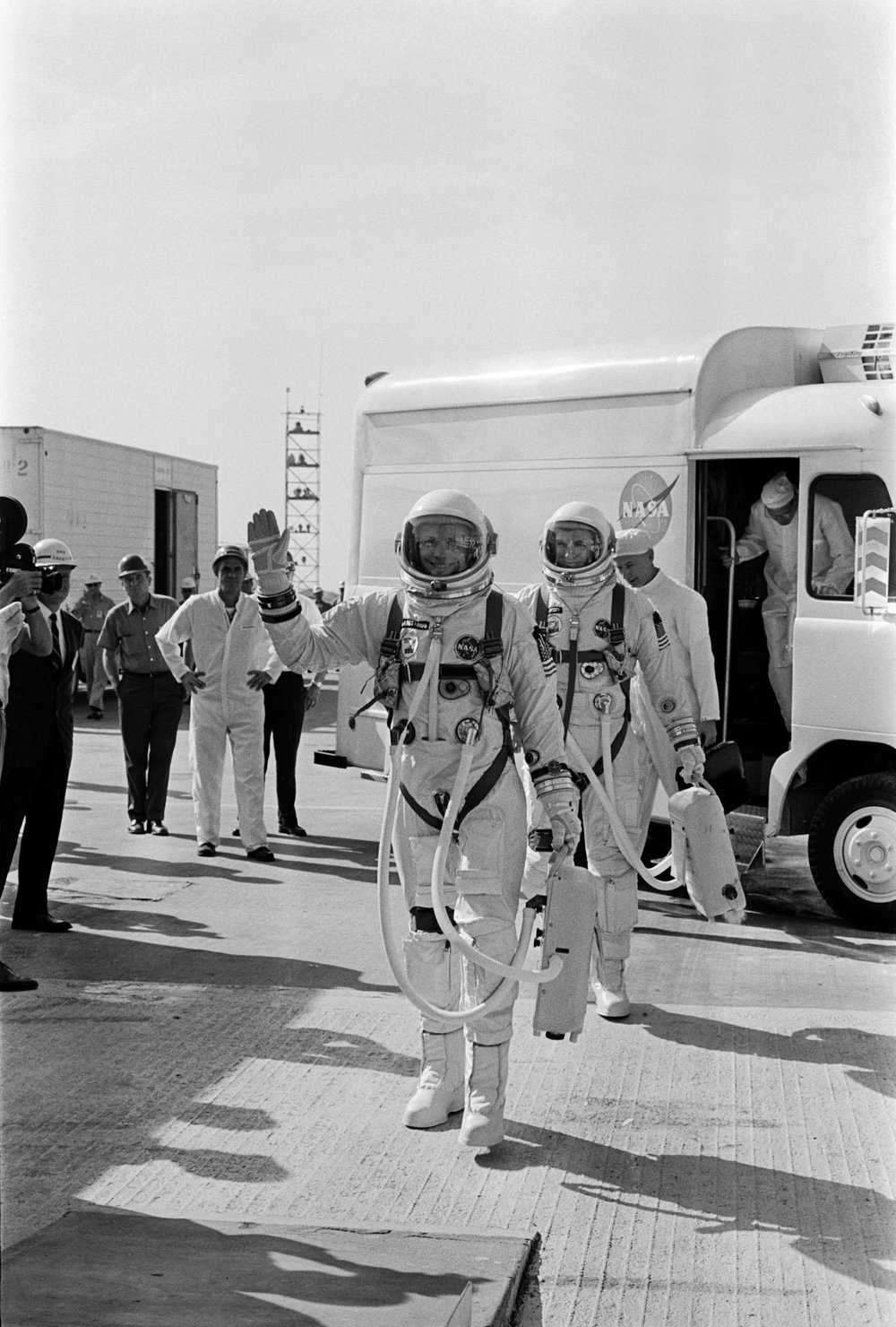 Astronauts Neil A. Armstrong and David R. Scott walk up the ramp at Pad 19 during the Gemini-8 prelaunch countdown. CAPE KENNEDY, FL 1966