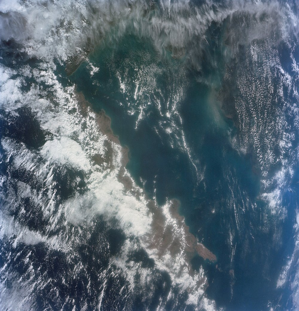 Photograph of Indonesia Java-Bali-Lombok-Borneo-Sumatra looking east; clouds; taken during the Gemini XI mission during orbit no. 26 on September 14,1966