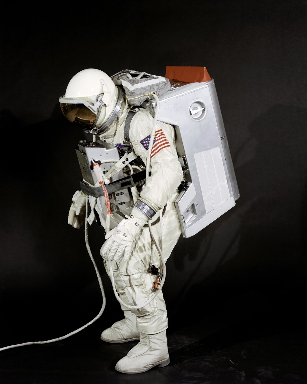 Fred Spross, Crew Systems Division, wears the spacesuit and extravehicular equipment planned for use by Gemini VIII astronaut David R. Scott