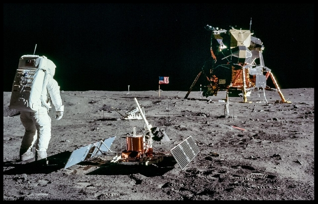 """Photographs showing Neil Armstrong taking his first 'small steps' on the moon are some of the most iconic images in the world. Now a Polish photographer has stitched together a collection of Nasa images into a series of stunning panoramas to show the Apollo missions like they've never been seen before. This one gives a fresh look at Apollo 11, including the famous flag, lander and footprints."" I mage- NASA, quote from dailymail .com"