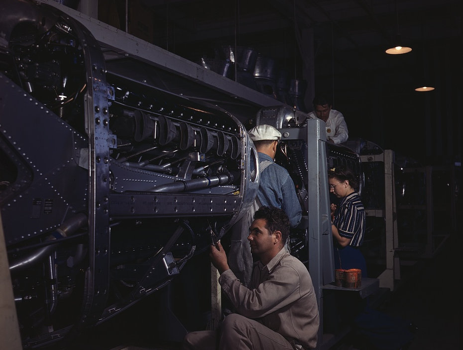 Employees at North American Aviation, Incorporated, assembling the cowling on Allison motors for the P-51 fighter planes, Inglewood, Calif. 1942