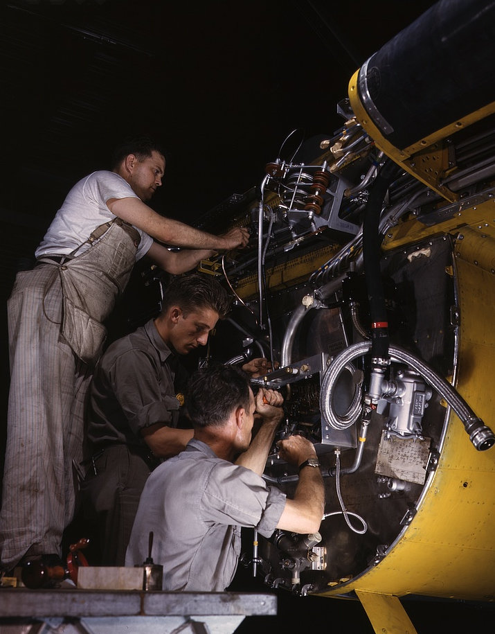 Making wiring assemblies at a junction box on the fire wall for the right engine of a B-25 bomber, North American Aviation, Inc., [Inglewood], Calif. 942