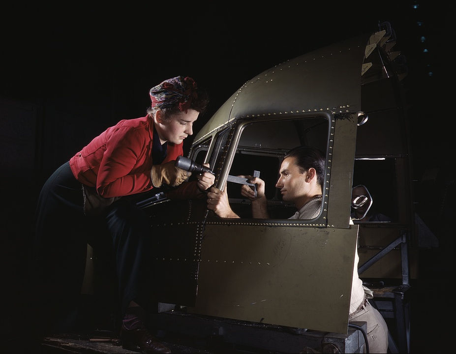 Riveting team working on the cockpit shell of a B-25 i.e. C-47 bomber at the plant of North American Aviation, Inc., Inglewood i.e. Douglas Aircraft Company, Long Beach, Calif.