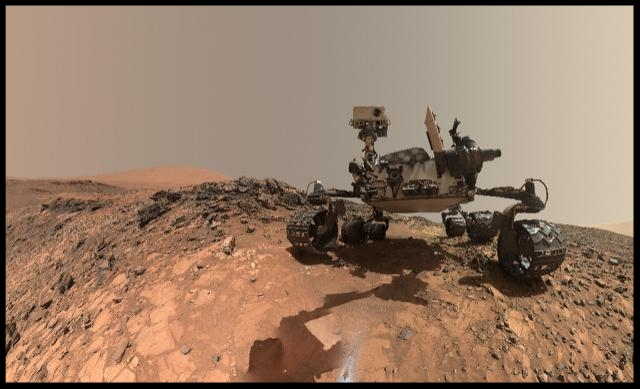Above- The new research was made possible by the discovery by NASA's Curiosity Mars rover of manganese oxides  (AFP Photo/HO)