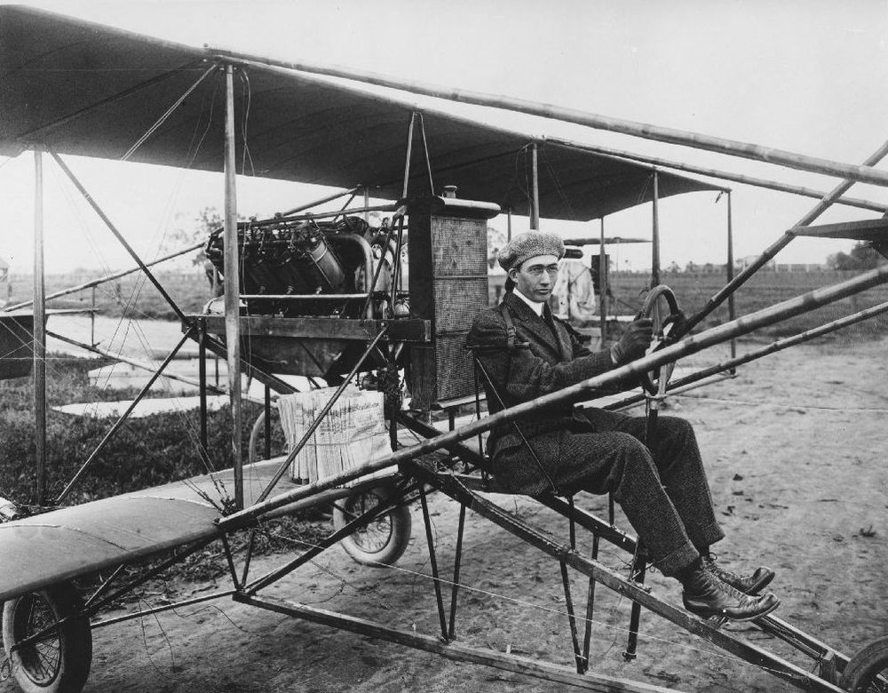 Above- Glenn L. Martin in pusher-biplane. Note the newspapers stacked on wing. Martin delivered newspapers from Fresno to Madera as a part of his promotional efforts to fund first plant. Photo circa 1912? Repository: San Diego Air and Space Museum Archive.