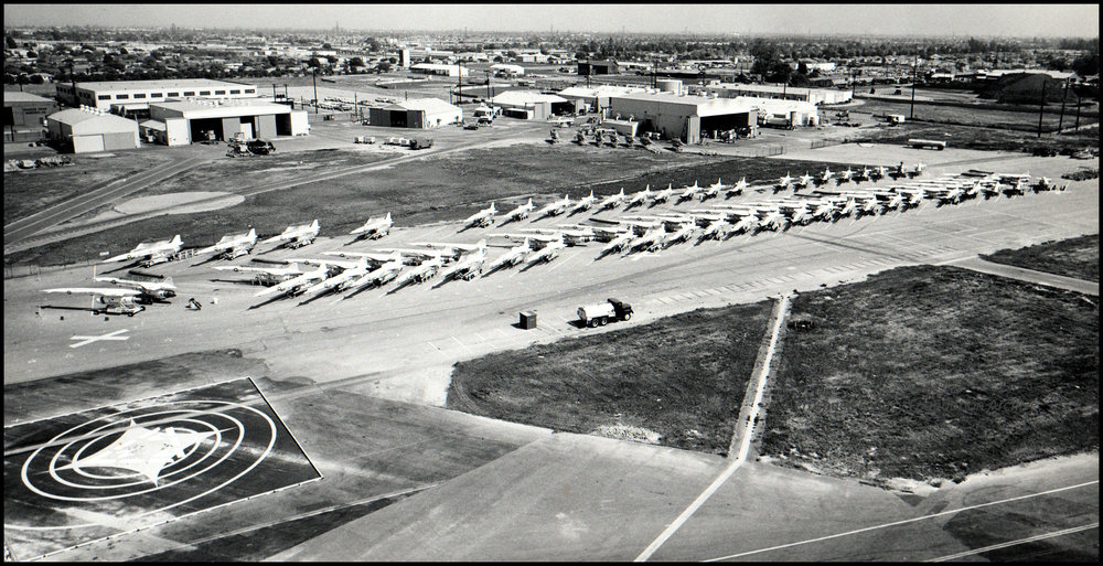 Above- Hound Dog missiles line the runway at North American Aviation Missile Division in Downey CA, 1959-1960. Facing southeast.