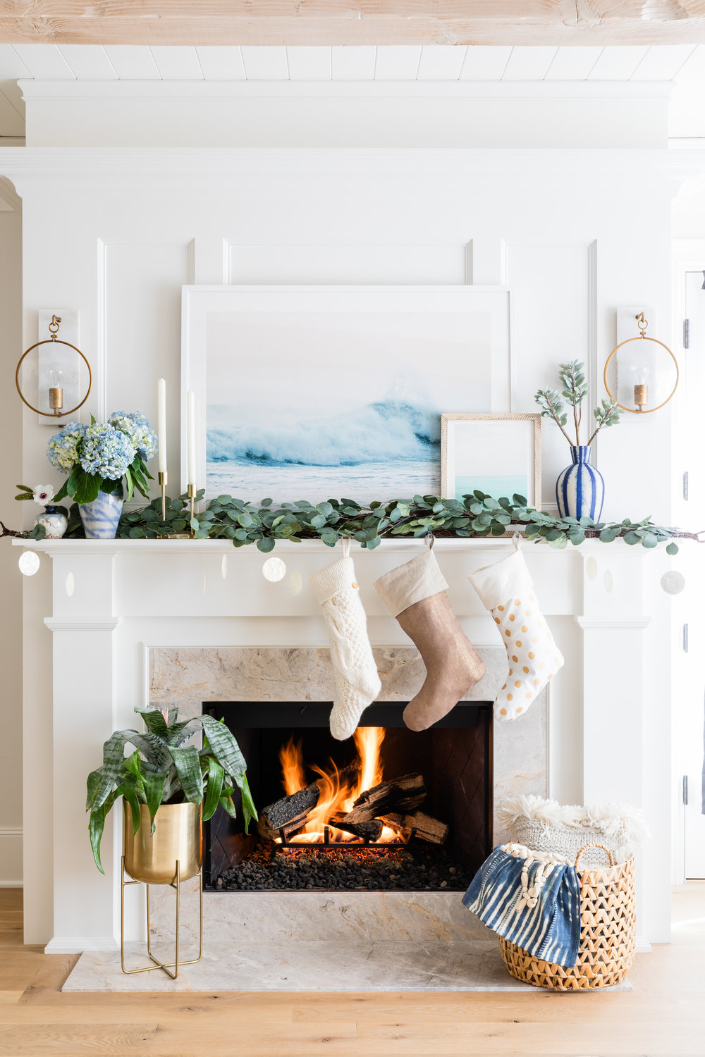 Pottery Barn and West Elm Christmas decor for beachy boho look on mantle.